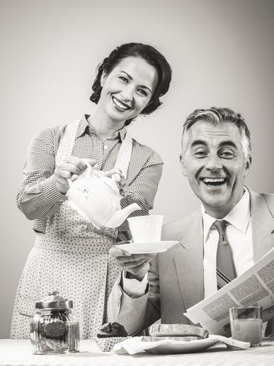 1950s style couple having breakfast
