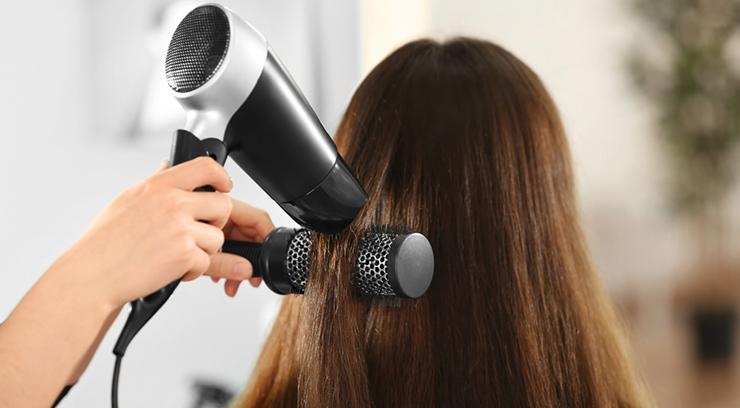 woman hair dried stylist