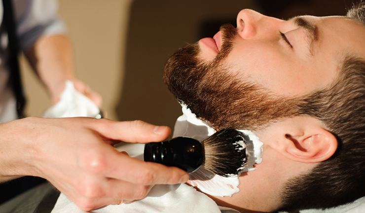 shaving beard in barbershop