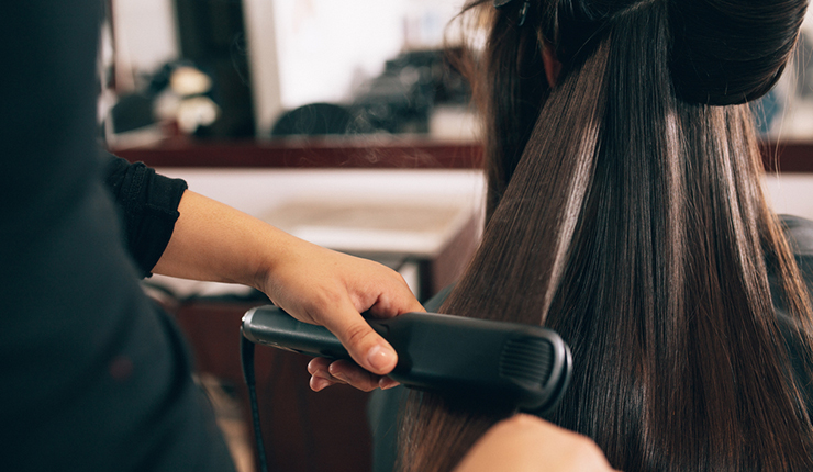professional hair styling with straigh iron
